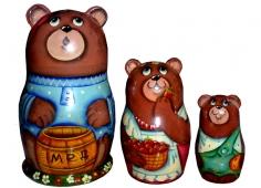 A bear with a barrel of honey